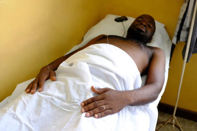 A local patient undergoing acupuncture shot on November 28..jpg
