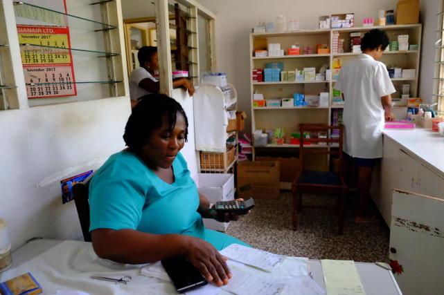 Ghanaian local nurse filmed at the clinic on November 28..jpg
